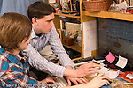 Teenage brothers ages 14 and 19 playing game on computer horizontal Caucasian