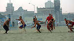Competitors spring to their feet during the Beach Flags event at the First Annual Asbury Park Beach Bar Lifeguard Competition held at the 3rd Avenue beach in Asbury Park.  ASBURY PARK, NJ  8/4/07  8:21:47 PM  PHOTO BY ANDREW MILLS