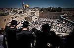 Ultra orthodox Jewish men overlook the wailing wall, Judaism most Holy site, and the Dome of the Rock mosque in Jerusalem Thursday March 28 2013. Thousands of Jewish worshipers gathered in Jerusalem to take part in  the tri-annual blessing of the Jewish people by members of the Jewish priestly caste at the Wailing Wall in Jerusalem. Jews named Cohen, considered descendants of the Temple's high priest, have the special duty of blessing the congregation three times a year.  Photo by Eyal Warshavsky.
