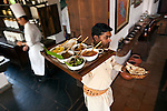 A waiter brings a lunch thali into the dining room at Mahua Kothi Lodge at Bandhavgarh National Park in Madhya Pradesh, in central India. The Park boasts one of the most densely populated Royal Bengal tiger areas in India drawing tourists from the world over to go on safari. Chittal, leopards, Langur monkeys and abundant bird life also thrive here in the parks wetlands and grassy plains. The Park closes for monsoon from July 1 to October 1.