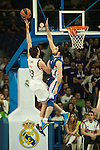 Real Madrid´s Sergio Llull and Anadolu Efes´s Dogus Balbay during 2014-15 Euroleague Basketball match between Real Madrid and Anadolu Efes at Palacio de los Deportes stadium in Madrid, Spain. December 18, 2014. (ALTERPHOTOS/Luis Fernandez)