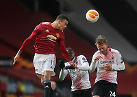Mason Greenwood of Manchester United, ManU gets up to head clear under pressure from Simon Kjaer of AC Milan during the UEFA Europa League match at Old Trafford, Manchester. Picture date: 11th March 2021. Picture credit should read: Andrew Yates/Sportimage/Imago/Insidefoto ITALY ONLY SPI-0952-0056