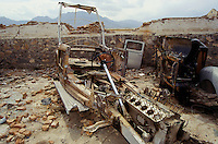 The remain of the convertible Rolls & Royce Phantom III and on the right the turn over Ford, in the destroy UNESCO bunker, in the courtyard of the Afghan Kabul National museum in Spring 1995.