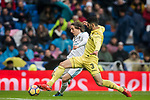 Luka Modric (L) of Real Madrid competes for the ball with Alvaro Gonzalez Soberon of Villarreal CF during the La Liga 2017-18 match between Real Madrid and Villarreal CF at Santiago Bernabeu Stadium on January 13 2018 in Madrid, Spain. Photo by Diego Gonzalez / Power Sport Images
