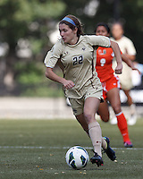 Boston College defender McKenzie Meehan (22) brings the ball forward. .After two overtime periods, Boston College (gold) tied University of Miami (orange), 0-0, at Newton Campus Field, October 21, 2012.