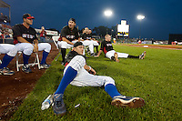 Members of the Western All-Stars relax and watch the final round participants during the Midwest League All-Star Home Run Derby at Modern Woodmen Park on June 20, 2011 in Davenport, Iowa. (David Welker / Four Seam Images)