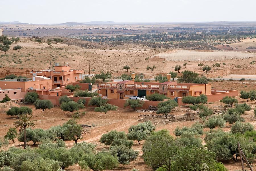 Jebal Nefusa, Libya - Houses near Issabiya. Metal or Masonry Water Storage Tanks on Rooftops.