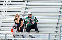 Jan. 16, 2013; Jupiter, FL, USA: NHRA top funny car driver John Force (right) talks with daughter, top fuel dragster driver Brittany Force during testing at the PRO Winter Warmup at Palm Beach International Raceway.  Mandatory Credit: Mark J. Rebilas-