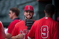 AZL Angels catcher Brett Bond (10) is congratulated by William Rivera (9) after his professional pitching debut during the completion of a suspended Arizona League game against the AZL Diamondbacks at Tempe Diablo Stadium on July 16, 2018 in Tempe, Arizona. The game was a continuation of the July 11, 2018 contest that was suspended by rain in the middle of the eighth inning. The AZL Diamondbacks defeated the AZL Angels 12-8. (Zachary Lucy/Four Seam Images)