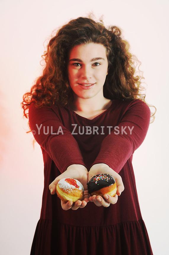 Hanukkah - woman with Doughnut