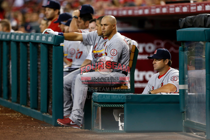 St. Louis Cardinals Manager Mike Matheny #22 watches a game against the Los Angeles Angels at Angel Stadium on July 3, 2013 in Anaheim, California. (Larry Goren/Four Seam Images)