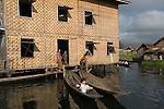 Extended family house made of Rattan built on stilts Inle Lake. Myanmar (Burma.) 2006.  .