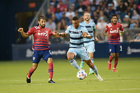 KANSAS CITY, KS - JULY 31: Khiry Shelton #11 Sporting KC with the ball during a game between FC Dallas and Sporting Kansas City at Children's Mercy Park on July 31, 2021 in Kansas City, Kansas.