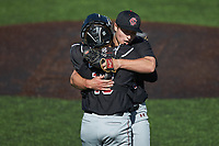 South Carolina Gamecocks relief pitcher Brett Kerry hugs catcher Colin Burgess (10) after getting the final out in the game against the Vanderbilt Commodores at Hawkins Field on March 21, 2021 in Nashville, Tennessee. (Brian Westerholt/Four Seam Images)