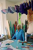 Gloria Cummins preparing costumes, Flamboyan, Fernhead Road, North Paddington, 2001.