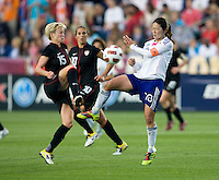 Megan Rapinoe (15) of the USWNT fights for the ball with Homare Sawa (10) of Japan during the game at WakeMed Soccer Park in Cary, NC.   The USWNT defeated Japan, 2-0.