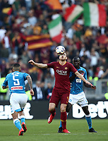Football, Serie A: AS Roma - SSC Napoli, Olympic stadium, Rome, March 31, 2019. <br /> Roma's Edin Dzeko (l) in action with Napoli's Kalidou Koulibaly (r) in action during the Italian Serie A football match between Roma and Napoli at Olympic stadium in Rome, on March 31, 2019.<br /> UPDATE IMAGES PRESS/Isabella Bonotto