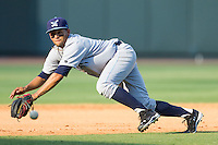 Wilmington Blue Rocks shortstop Jack Lopez (11) dives for a ground ball during the game against the Winston-Salem Dash at BB&T Ballpark on July 6, 2014 in Winston-Salem, North Carolina.  The Dash defeated the Blue Rocks 7-1.   (Brian Westerholt/Four Seam Images)
