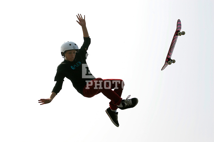 Skateboarder Rob Longley, 13, of Downingtown, Pennsylvania gets big air and bails on his trick after going off of the resi (short for resin) jumps at Camp Woodward in Woodward, Pennsylvania.  August 10, 2005.