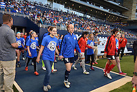 Kansas City, Kansas - Saturday April 16, 2016: FC Kansas City defender Becky Sauerbrunn (4) walks to the pitch before the game against Western New York Flash at Children's Mercy Park. Western New York won 1-0.