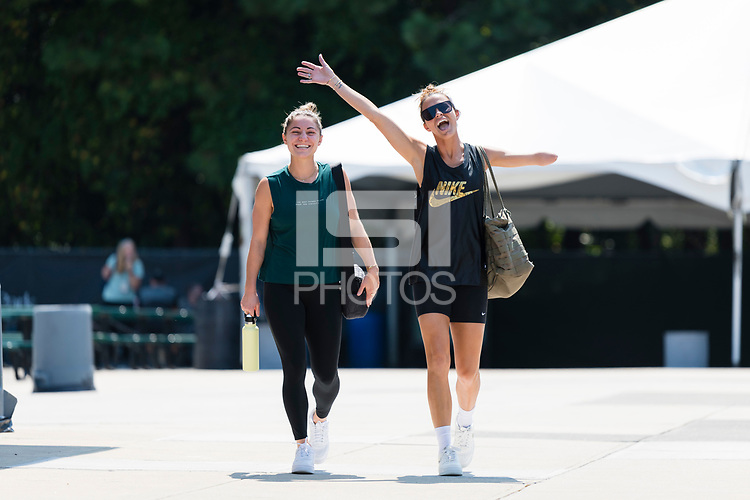 CARY, NC - SEPTEMBER 12: Rylee Baisden #29 and Carson Pickett #4 of the NC Courage arrive at Sahlen's Stadium before a game between Portland Thorns FC and North Carolina Courage at WakeMed Soccer Park on September 12, 2021 in Cary, North Carolina.