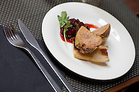 Homemade foie gras, marinated with port and poached, is served with a strawberry compote at restaurant 'Chat Noir, Chat Blanc', Nice, France, 10 April 2012