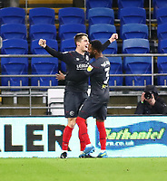 26th December 2020; Cardiff City Stadium, Cardiff, Glamorgan, Wales; English Football League Championship Football, Cardiff City versus Brentford; Sergi Canós of Brentford celebrates scoring his hattrick with team mate Rico Henry after making it 1-3 in the 72nd minute