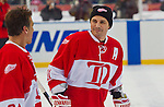 31 December 2013: Former Detroit Red Wings forward Sergei Fedorov (91) talks with Former Detroit Red Wings defenseman Chris Chelios (24) during warmups before the Toronto Maple Leafs v Detroit Red Wings Alumni Showdown hockey game, at Comerica Park, in Detroit, MI.