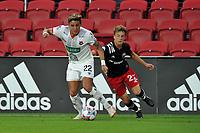 WASHINGTON, DC - JULY 7: Barlon Sequeira #22 of Liga Deportiva Alajuense battles for the ball with Griffin Yow #22 of D.C. United during a game between Liga Deportiva Alajuense  and D.C. United at Audi Field on July 7, 2021 in Washington, DC.