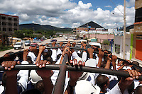 Bolivian Navy officers travel together in a truck as they prepare for the arrival of Evo Morales, near the naval base of Puerto Suarez. Bolivia lost what is now northern Chile in a war over nitrates leaving Bolivia without access to the ocean.