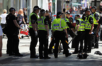 Pictured: Police officers lift man hole covers in Queen Street, the main shopping district of Cardiff Thursday 25 May 2017<br /> Re: Preparations for the UEFA Champions League final, between Real Madrid and Juventus in Cardiff, Wales, UK.
