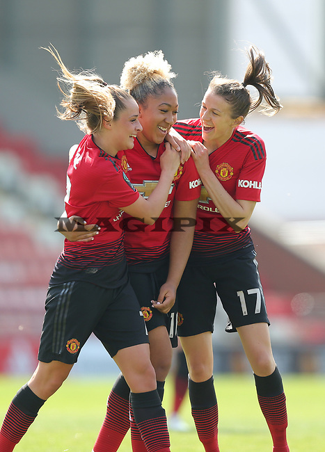 Lauren James of Manchester United Women cele with Lizzie Arnot of Manchester United Women and Ella Toone of Manchester United Women