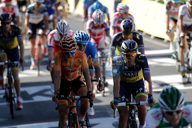 The main bunch including Alberto Contador (ESP) Team Saxo-Tinkoff cross the finish line at the end of Stage 6 of the 100th Edition of the Tour de France 2013 from Aix-En-Provence to Montpellier 4th July 2013.<br /> (Photo: Eoin Clarke/ www.newsfile.ie)