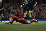 Wales scrum half Rhys Webb dives over to score a try.<br /> Dove men Series 2014<br /> Wales v New Zealand<br /> 22.11.14<br /> ©Steve Pope -SPORTINGWALES