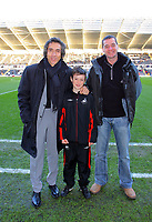 ATTENTION SPORTS PICTURE DESK<br /> Pictured: Paulo Sousa manager of Swansea City with mascot <br /> Re: Coca Cola Championship, Swansea City Football Club v Nottingham Forest at the Liberty Stadium, Swansea, south Wales. Saturday 12 December 2009