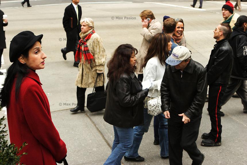 Woman waiting; Bryant Park on Sixth Avenue.; 135pm, 08Feb2006