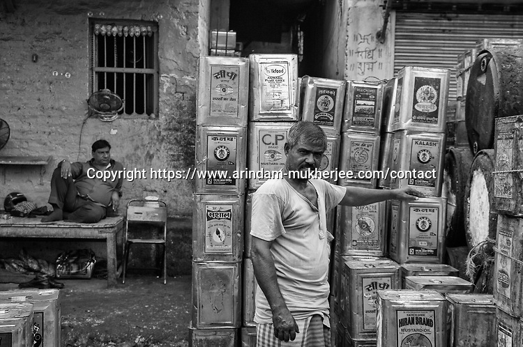 A labour who works at a mustard oil stockist at Burrabazar in Kolkata, India.