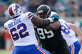 Jacksonville Jaguars Eli Ankou (99) rushes against Vlad Ducasse (62) during an NFL Wild-Card football game against the Buffalo Bills, Sunday, January 7, 2018, in Jacksonville, Fla.  (Mike Janes Photography)