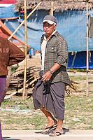 Myanmar, Burma.  Burmese Man Wearing a Longyi, the Burmese Wrap-around Sarong, and Sandals.  Inle Lake, Shan State.