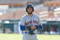 Scottsdale Scorpions catcher Ali Sanchez (25), of the New York Mets organization, walks back to the dugout during an Arizona Fall League game against the Glendale Desert Dogs at Camelback Ranch on October 16, 2018 in Glendale, Arizona. Scottsdale defeated Glendale 6-1. (Zachary Lucy/Four Seam Images)