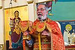 Fr. Steve Tumbas celebrates the Christmas Liturgy service, at St. Sava Serbian Orthodox Church. The Orthodox faith observes the Julian Calendar follows the traditional calendar by two weeks, thus Christmas is on January 7.