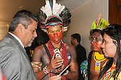 Itamawi Pataxo and two Kayapo Indians talk to a Federal Deputy during an audience in Congress. Brasilia, Brazil, 10th November 2015. Photo © Sue Cunningham, pictures@scphotographic.com