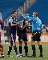 New England Revolution midfielder Marko Perovic (29) and New England Revolution forward Ilija Stolica (9) plead red card issued by   referee Jasen Anno. In a Major League Soccer (MLS) match, Real Salt Lake defeated the New England Revolution, 2-0, at Gillette Stadium on April 9, 2011.