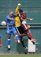 Venezuela goal keeper Rafael Romo (1) goes up to defend the play against El Salvador defender Cristian Esnal (4). El Salvador National Team defeated Venezuela 3-2 in an international friendly at RFK Stadium, Sunday August 7, 2011.