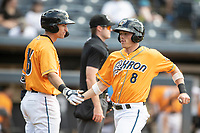 Akron RubberDucks outfielder Alex Call (8) is greeted at the plate by teammate Jonathan Engelmann (13) on June 27, 2021 against the Erie SeaWolves at Canal Park in Akron, Ohio. (Andrew Woolley/Four Seam Images)