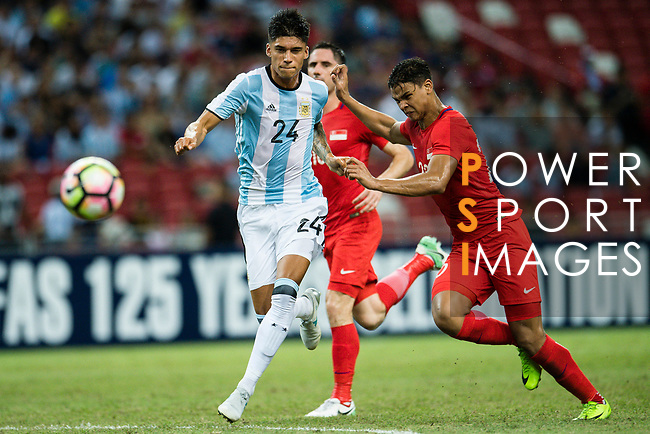 Carlos Correa of Argentina (L) fights for the ball with Irfan Fandi of Singapure (R) during the International Test match between Argentina and Singapore at National Stadium on June 13, 2017 in Singapore. Photo by Marcio Rodrigo Machado / Power Sport Images