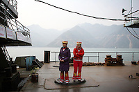 CHINA. Hubei Province. Two villagers dressed in traditional clothes near the  3 Gorges.  The flooding of the three Gorges, by damming the Yangtze near the town of YiChang, has remained a controversial subject due to the negative environmental consequences and the displacement of millions of people in the flood plain. The Yangtze River however is reported to be at its lowest level in 150 years as a result of a country-wide drought. It is China's longest river and the third longest in the world. Originating in Tibet, the river flows for 3,964 miles (6,380km) through central China into the East China Sea at Shanghai.  2008.