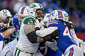 New York Jets Brian Winters (67) blocks Tremaine Edmunds (49) during an NFL football game against the Buffalo Bills, Sunday, December 9, 2018, in Orchard Park, N.Y.  (Mike Janes Photography)