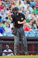 Home plate umpire Greg Stanzak makes a strike call during the Pacific Coast League game between the Oklahoma City RedHawks and the Nashville Sounds at Greer Stadium on July 25, 2014 in Nashville, Tennessee.  The Sounds defeated the RedHawks 2-0.  (Brian Westerholt/Four Seam Images)