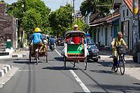 Yogyakarta, Java, Indonesia.  Street Scene, with Two Becaks (Man-powered, three-wheeled rickshaw taxis).